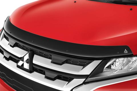A close-up shot of tinted bonnet protector on a red Mitsubishi ASX