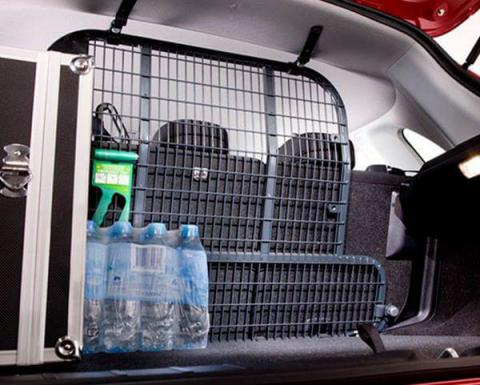 Cargo barrier with a pack of bottled water in back trunk