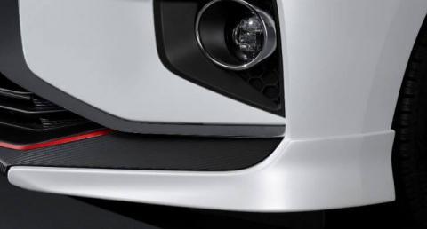 A close up shot of lamp garnish kit of a white Mitsubishi Mirage