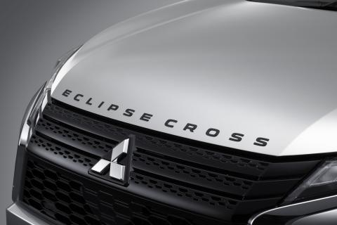 The Mitsubishi Eclipse Cross badge on the front of a vehicle in black