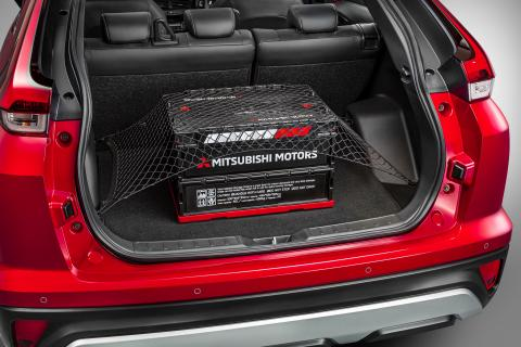 The open boot of a Mitsubishi Eclipse Cross with a luggage net in it