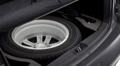 A full size spare wheel and fitting kit in back trunk