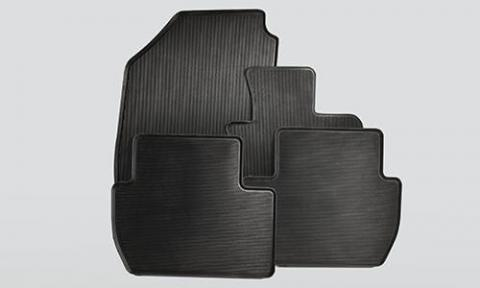 Rubber mats for the front and rear of a club cab Triton