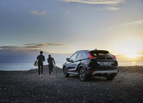 A Mitsubishi Eclipse Cross parked at the beach during sunrise