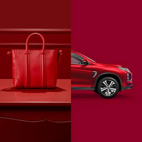 A red hand bag and a red Mitsubishi ASX side by side