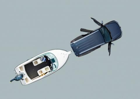 Illustration of a Pajero Sport towing a boat