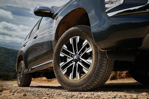 A close up shot of a Pajero Sport on a dusty road