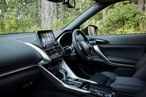 An interior shot of the Mitsubishi Eclipse Cross showing a forest in outside of the car