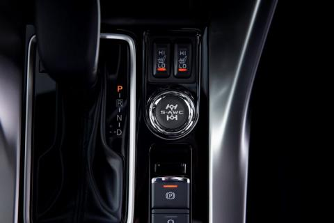 A close up top drop down shot of the drive mode controls for the Mitsubishi Eclipse Cross