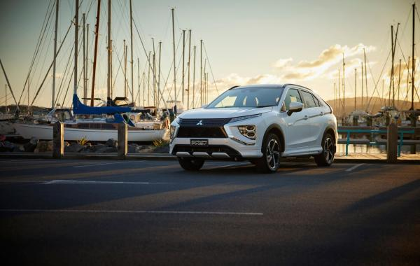 An Eclipse Cross PHEV parked at a marina